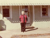 Mary Jo McMichael in front of cafe, 1978